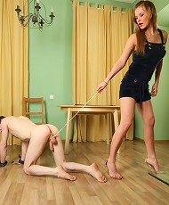 Blond mistress uses a noose around slaves aching balls instead of a leash