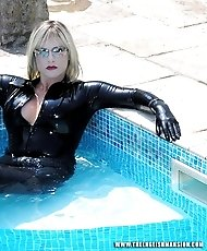Lady Nina Birch takes a refreshing swim, while wearing her hot rubber catsuit.