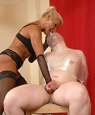 Mummified slave in plastic wrap gets his balls tortured by a horny domina