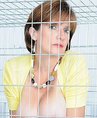 Caged busty milf